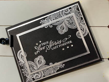 """Photo of silver embossed black anniversary card made using the """"True Love Stories Last Forever"""" sentiment from Elegantly Said by Stampin' Up!"""