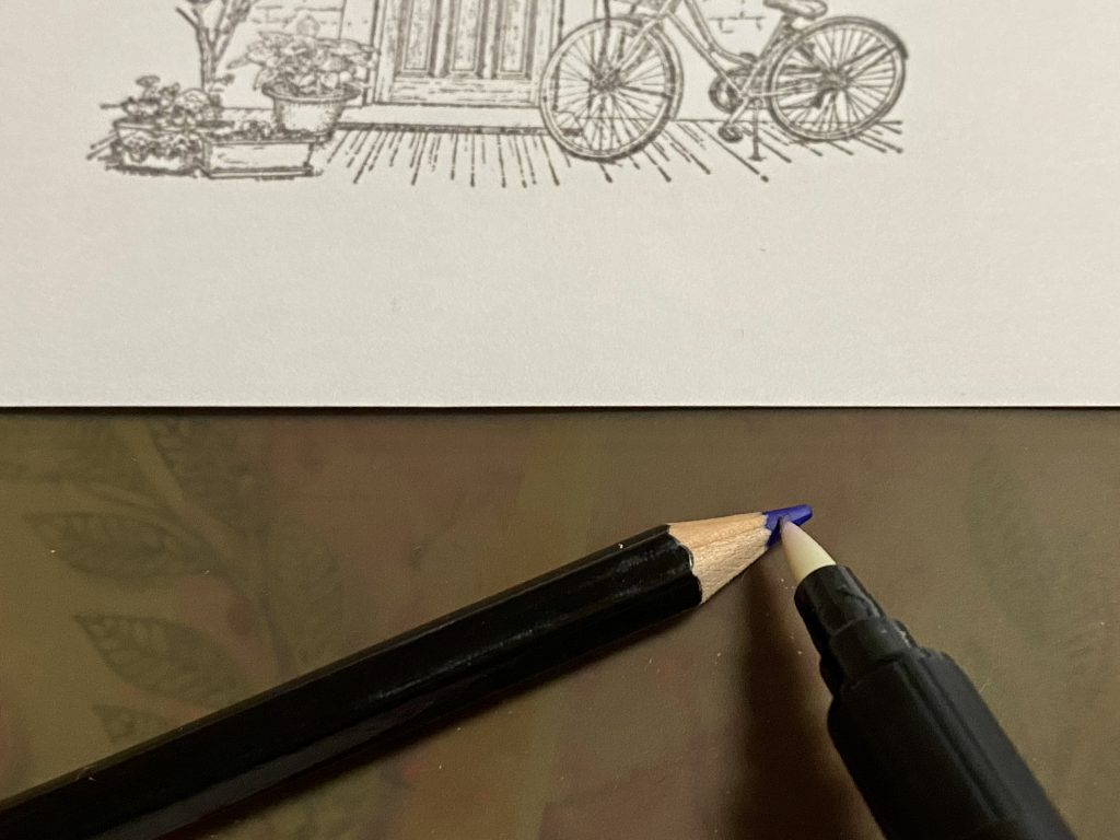 Photo showing how to pick up color from a watercolor pencil using your blender pen.