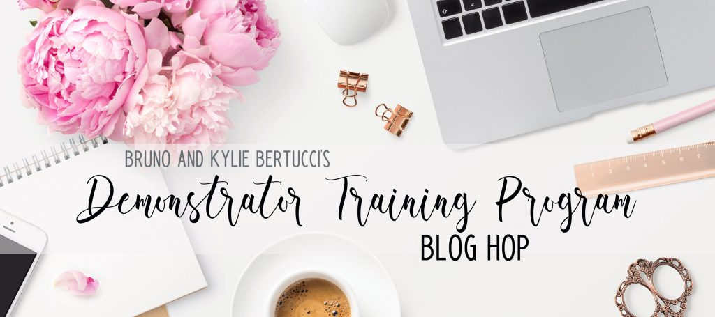 Graphic announcing the Bruno and Kyle Bertucci's Demonstrator Training Program blog hop. Lap top, flower, sketch pad and coffee are visible in the photo.