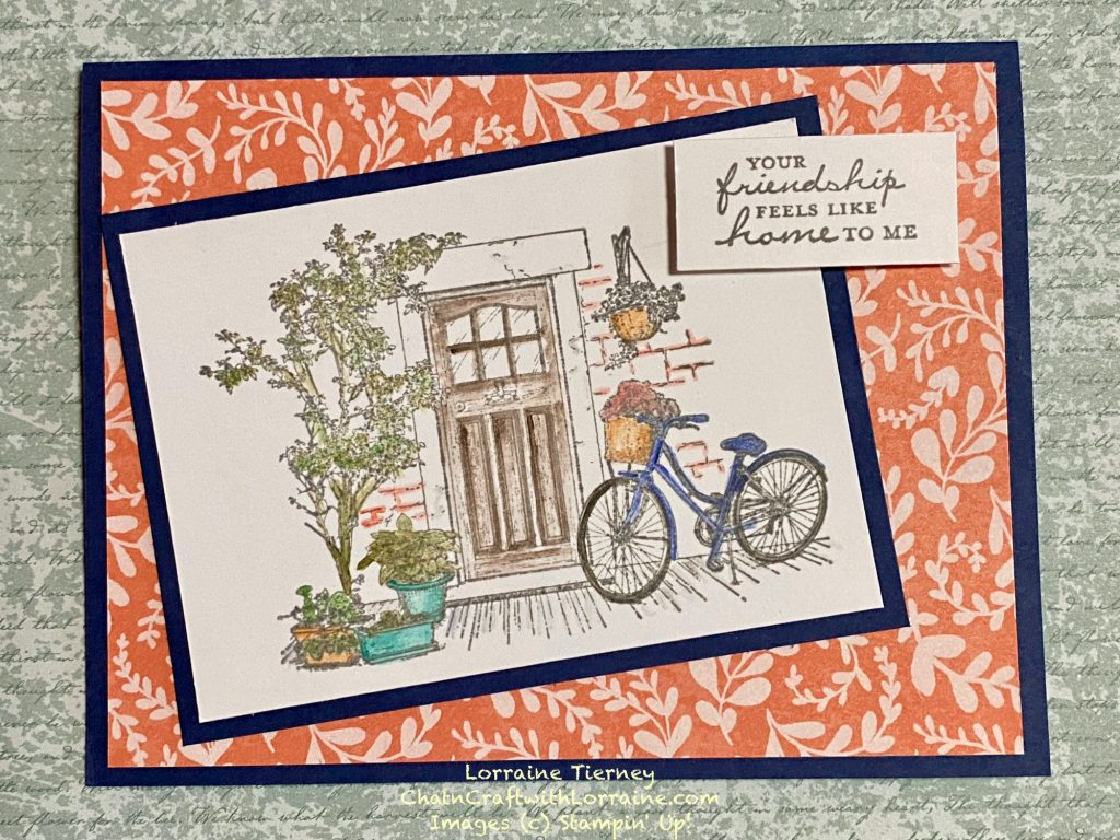 Handmade card featuring the Feels Like Home stamp set with Night of Navy and Calypso Coral and colored with watercolor pencils and the blender pen.