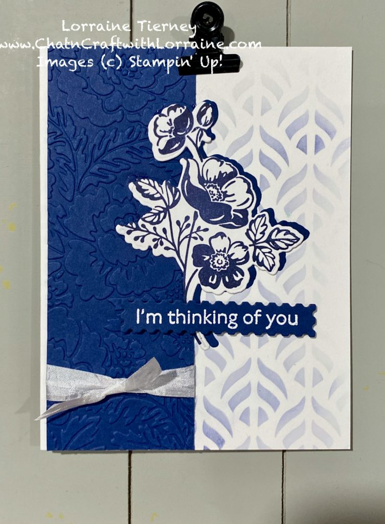 Photo of a handmade card with stenciled background and card stock embossed with the Pretty Flowers embossing folder by Stampin' UP! Shaded Summer flowers and a heat embossed sentiment make this card lovely.