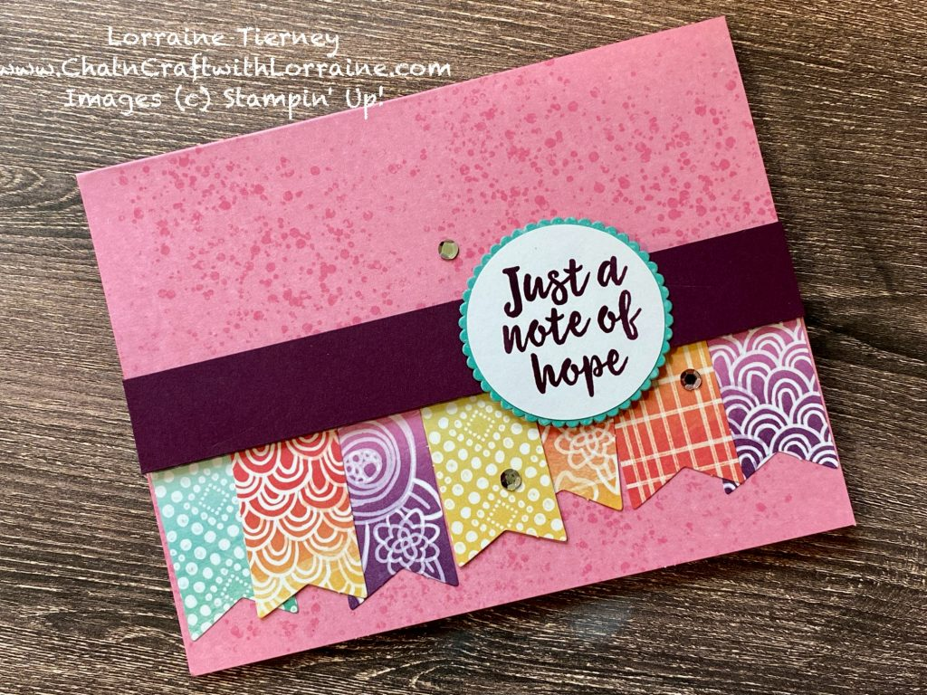 """Photo of a card in Melon Mambo and other bright colors with banners and a sentiment of """"Just a note of Hope"""""""