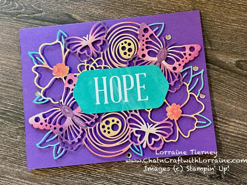 """Photo of a card in Gorgeous Grape with a brightly colored die cut of butterflies and flowers and a large sentiment """"Hope."""""""