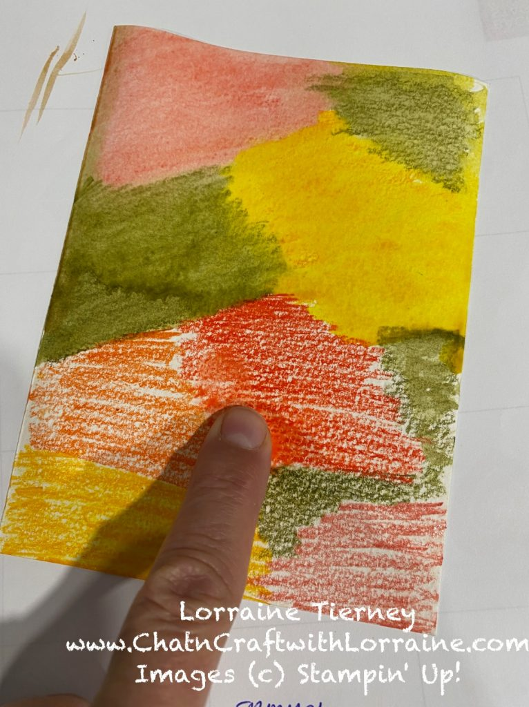 Photo of colored pencil coloring on a piece of water color paper. Colored pencil is being blended with water.