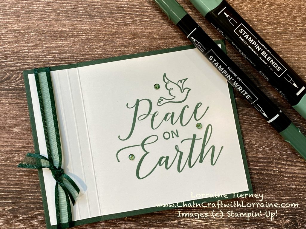 Photo of a book fold card with a scored frame and Peace on Earth stamped in Soft Succulent on an Evening Evergreen card base.