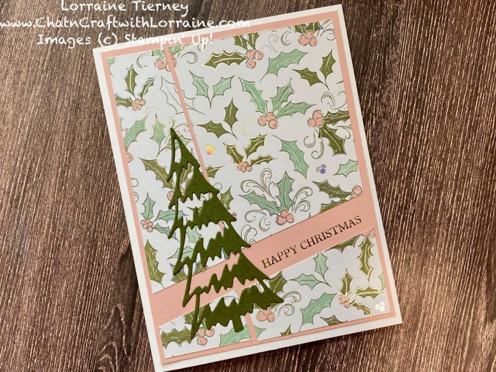 Photograph of a Quick and Easy Card Front using Whimsy & Wonder patterned paper with a die cut Christmas tree by ChatnCraft with Lorraine.