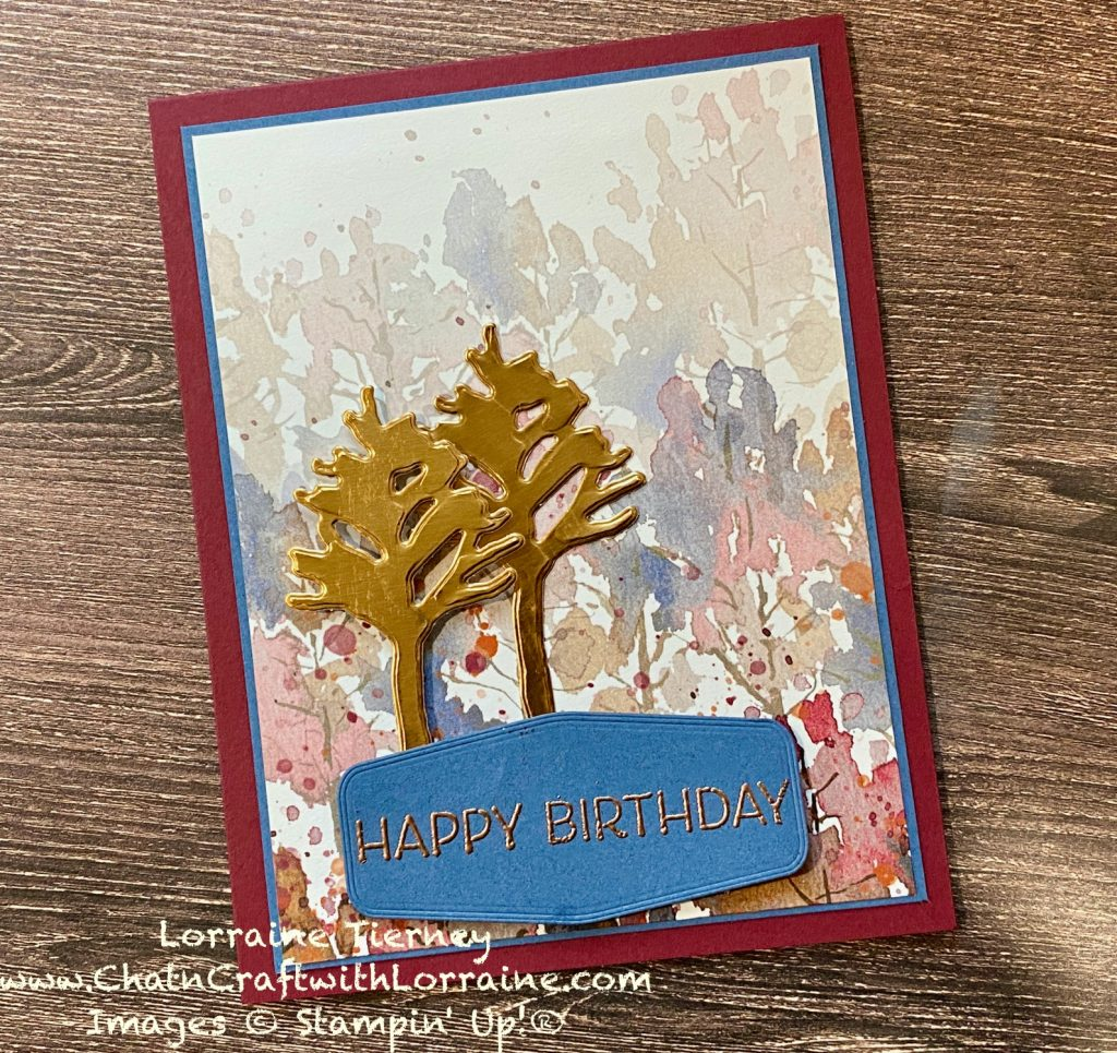 Photo of Beauty of Earth patterned paper in Merry Merlot and Misty Moonlight with trees and leaves. Die cut trees made of shiny copper foil with the Happy Birthday sentiment