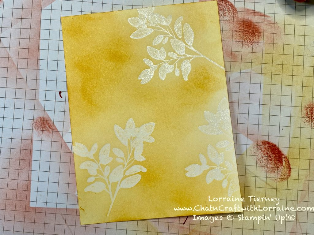 Photo of the second step to make the card. Embossed leaves and Bumblebee ink being blended over the leaves and onto the card stock.