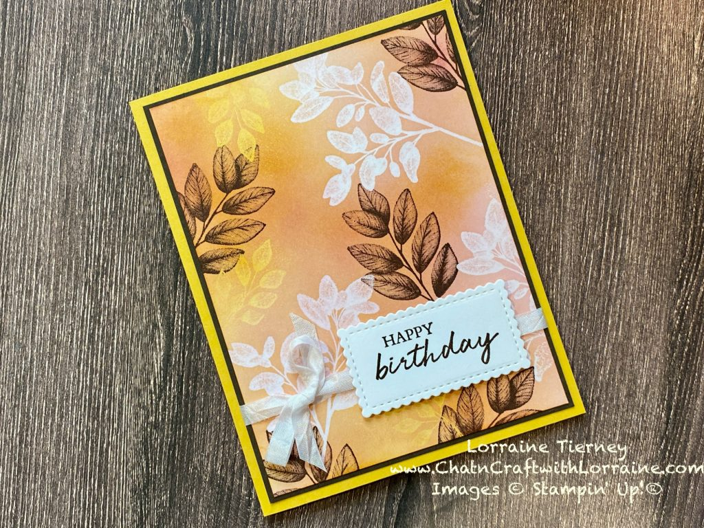 Photo of the finished card with two layers of embossed leaves and two layers of ink. Happy Birthday is the sentiment in the lower right hand corner.