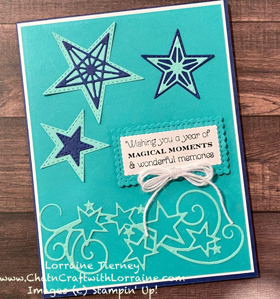 """Photo of a card with Night Of Navy card base, white, Coastal Cabana, and Bermuda Bay. Sentiment  reads, """"Wishing you a year of Magical Moments & wonderful memories. Card is decorated with stitched stars and swirls."""