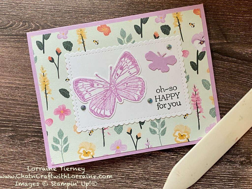 """Photo of a Pansy Petals card with two die cut butterflies in Fresh Freesia. The sentiment reads """"Oh-so happy for you."""""""