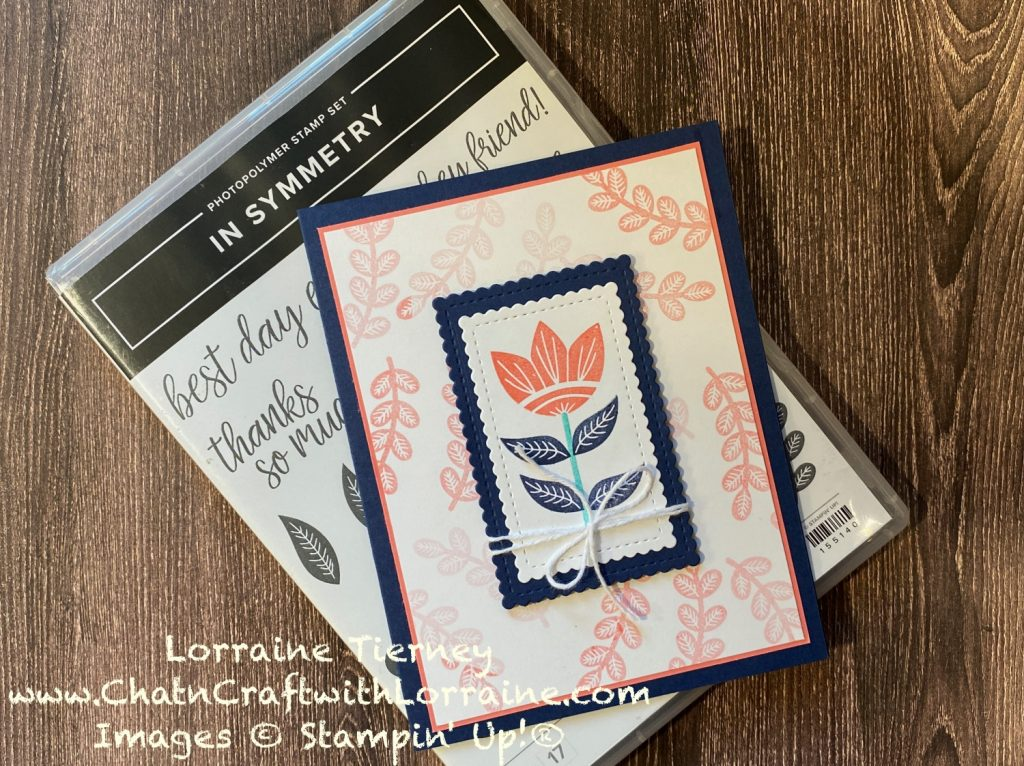 Photo of In Symmetry card with background of leaves stamped in Calypso Coral on a white mat.