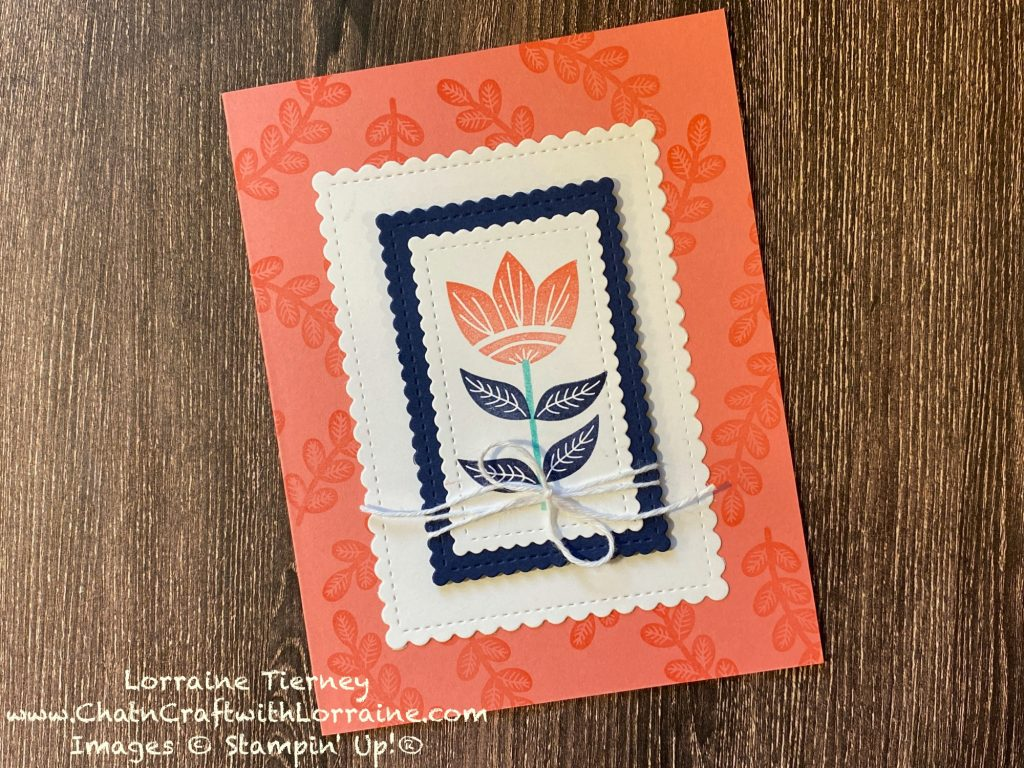 Photo of a Calypso Coral Card with background stamping also done in Calypso Coral. Focal image of a flower is centered on the front.