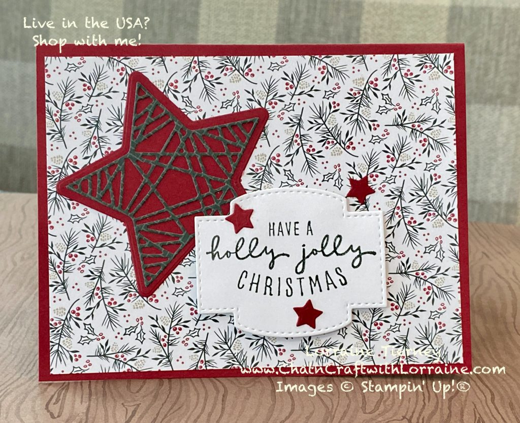 """Photo of handmade card with Cherry Cobbler base and holly patterned paper, with a large star and the message """"Have a holly jolly Christmas."""""""
